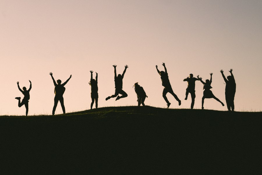 Silhouette of people jumping - val-vesa-624638-unsplash